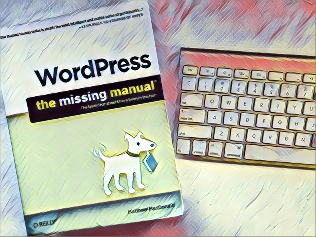 WordPress the Missing Manual sitting on desk next to keyboard